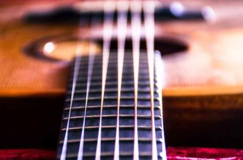 acoustic-guitar-strings-close-up-on-fredboard