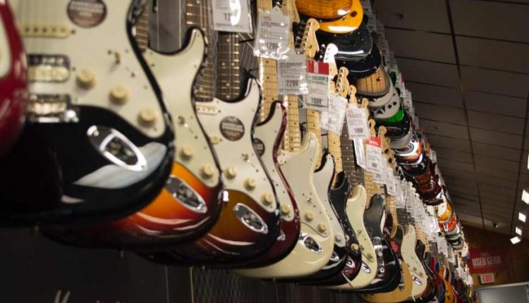 electric-guitars-hanging-in-wall