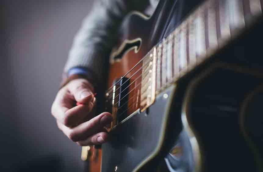 guitarist-playing-electric-guitar-close-up